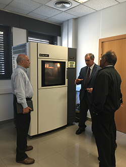 Penn State faculty members Sanjay Joshi and M. Jeya Chandra are shown one of the 3D printers at the Institut Quimic de Sarria in Spain